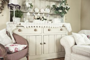 large shabby chic dresser with white sofa and pink chair